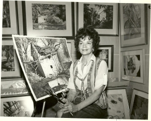 The late Phyllis Good with her painting of the John Wallace Springhouse
